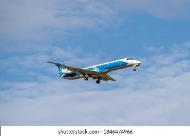 Boryspil, Ukraine - September 25, 2020: Ukraine International Airlines Embraer ERJ-195 is landing in the airport