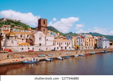 BOSA, ITALY - May, 17, 2018: The Temo river bank with the Serravalle's Castle on the background. Bosa - one of small colourful villages on Sardinia island.