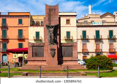 Bosa, Sardinia / Italy - 2018/08/13: Memorial of the Fallen - Monumento ai Caduti - at the Corso Vittorio Emanuele in the Bosa city center