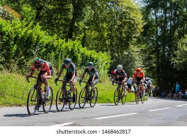 Bosdarros, France - July 19, 2019: Group of female cyclists riding in Bosdarros during La Course by Le Tour de France 2019