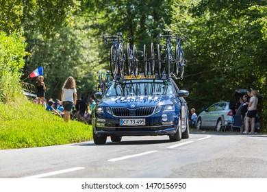 Bosdarros, France - July 19, 2019: The car of feminine Team Virtu Cycling drives in Bosdarros during La Course by Le Tour de France 2019