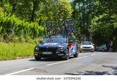 Bosdarros, France - July 19, 2019: The car of feminine Team Team WNT-Rotor Pro Cycling drives in Bosdarros during La Course by Le Tour de France 2019