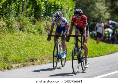 Bosdarros, France - July 19, 2019: Two female cyclists (Shara Gillow of  FDJ and Edwige Pitel of Cogeas-Mettler) ride in Bosdarros during La Course by Le Tour de France 2019