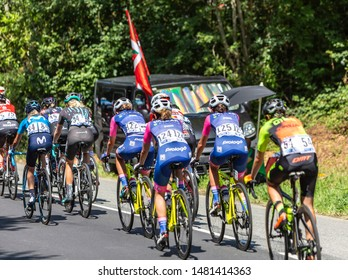 Bosdarros, France - July 19, 2019: Rear view of the feminine peloton riding in Bosdarros during La Course by Le Tour de France 2019
