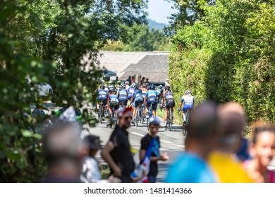 Bosdarros, France - July 19, 2019: Rear view of the feminine peloton riding in Bosdarros during La Course by Le Tour de France 2019