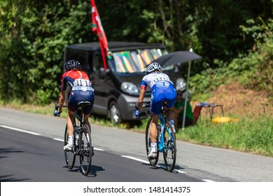 Bosdarros, France - July 19, 2019: Rear view of two female cyclists (Shara Gillow of  FDJ and Edwige Pitel of Cogeas-Mettler) ride in Bosdarros during La Course by Le Tour de France 2019