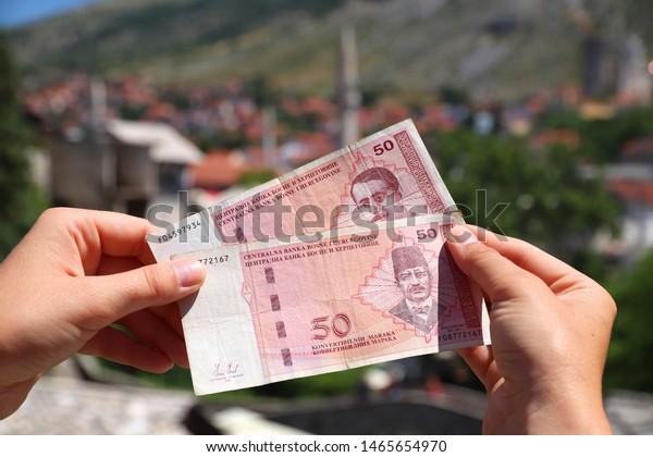 Bosnia and Herzegovina convertible mark. Bosnian currency with Mostar city in background.