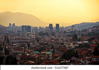 BOSNIA AND HERZEGOVINA, SARAJEVO - AUGUST 27: Sarajevo city panoramic shot from a hill at sunset on August 27, 2016 in Sarajevo.