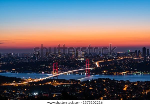 Bosphorus Bridge with its new name 15th July martyrs bridge sunset ( Turkish Bogazici Koprusu yeni ismi 15 temmuz sehitleri koprusu gece gorunusu)