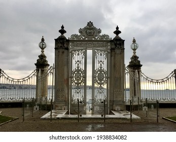 Bosphorus gate at Dolmabahce palace in Istanbul, Turkey. Twilight, clouds, entry, baroque gateway. Date of photo is 03.01.2019. Horizontal