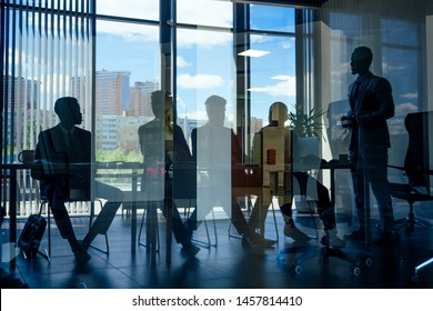 boss afro businessmen talking with arab partners colleague, multiethnic team in the office with panorama window.