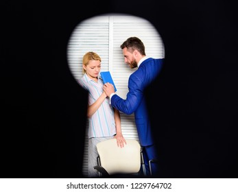 Boss aggressive threatening violence. Witness of office crime. Woman suffer violence in office. Dirty secret and blackmail. Discrimination and violence. Occupational violence. View through keyhole.