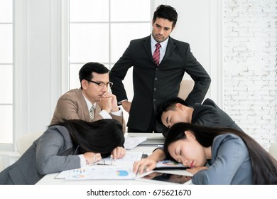 Boss angry when business people team sleeping on meeting room in office. Business people team tired after working hard.