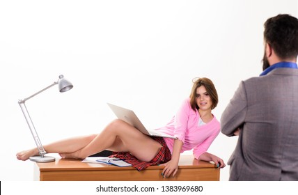 Boss bearded man excited about sexy secretary. Temptress relaxing on table. Such a tease. Office manager or sexy secretary. Sexy personal secretary. Full of desire. Sexy lady worker attractive legs.
