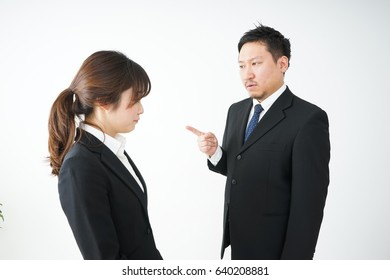 Boss being angry with young business person
