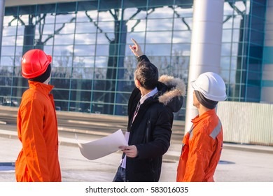 boss or Chief shows a construction project. Team of  young engineers . Business modern background