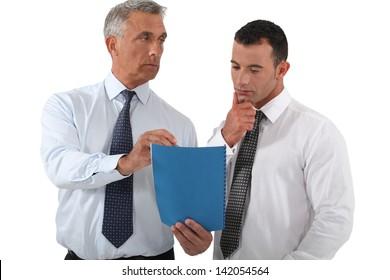 Boss delegating work to employee