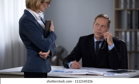 Boss flirting colleague in office, old man crush, sexist attitude to subordinate