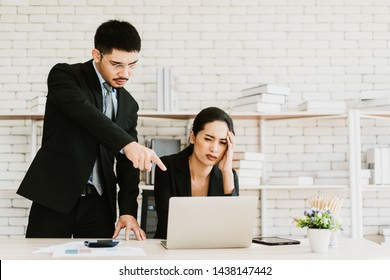 Boss giving order or firing employee. Powerful business man pointing laptop with finger.Angry executive or manager. Tough leadership, strict discipline, workplace bullying or fight at work.