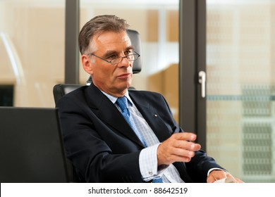 Boss in his office - presumably he is in a meeting