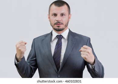 Boss holding his fists up