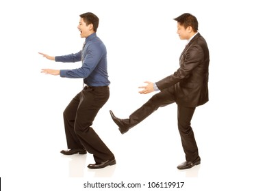 A boss kicking out an employee (isolated on white)