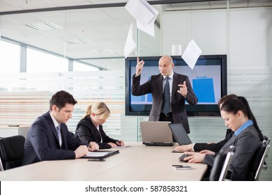 Boss lost his temper during the meeting. Scared employees are staring down.