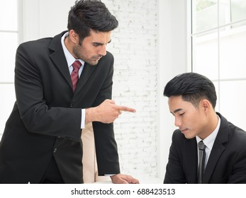 Boss pointing finger to the team member upset and complaining on target sales failure