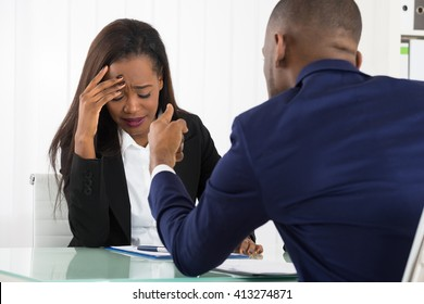 Boss Pointing At Her Young Female Female In Office