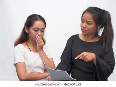 A boss reprimanding a female staff