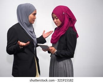 A boss reprimanding her staff.