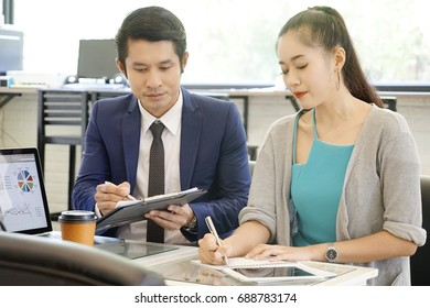 boss and Secretary meeting. Hand of woman holding notebook for working while meeting team. Woman working concept.