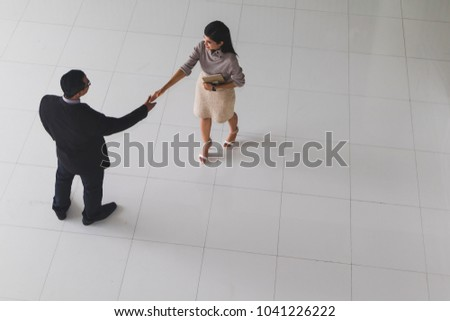 Boss secretary shaking hands greet each stock photo edit now boss and secretary are shaking hands to greet each other at the lobby of the office m4hsunfo