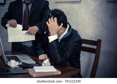 Boss shouting at employee and Ripping the document
