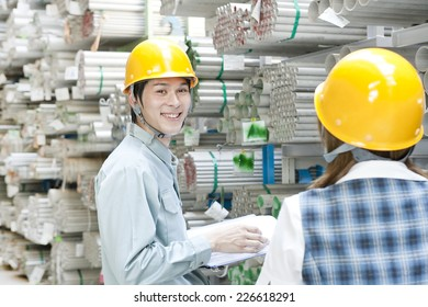 Boss and subordinate working in warehouse