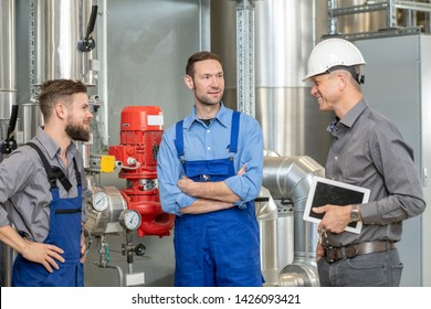 boss with two worker in conversation in  factory