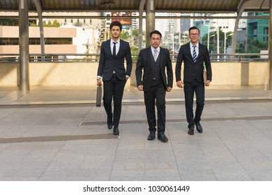 Boss is walking with his subordinates.