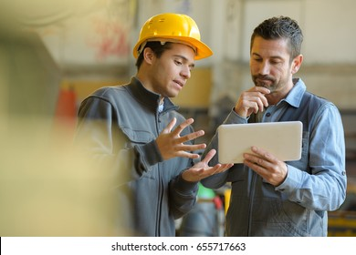 boss and worker checking results on the tablet
