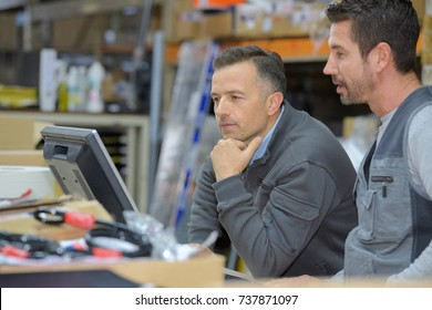 boss and worker checking results on pc