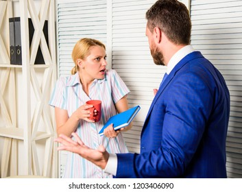 Boss and worker discuss working plan. Office quarrel concept. Misunderstanding between colleagues. Tense conversation or quarrel between colleagues. Prejudice and personal attitude to employee.