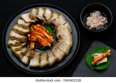 Bossam, boiled pork is eaten with spicy radish and Salted shrimp