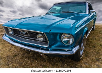 BOSSCHENHOOFD / NETHERLANDS - JUNE 17, 2018: A shiny classic Ford Mustang on display at an old-timer meeting in Bosschenhoofd