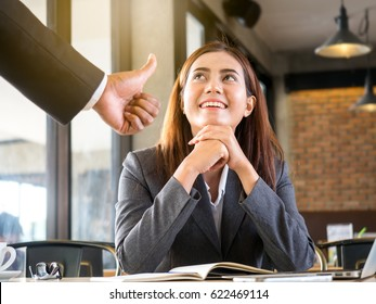 Boss/employer admires to young Asian businesswoman/staff/employee with smiling face for her success and good/best in work.