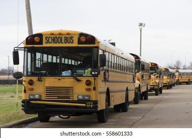 BOSSIER CITY, LA., U.S.A., JAN. 16, 2017: School buses are parked beside a Bossier Parish, Louisiana, public school.