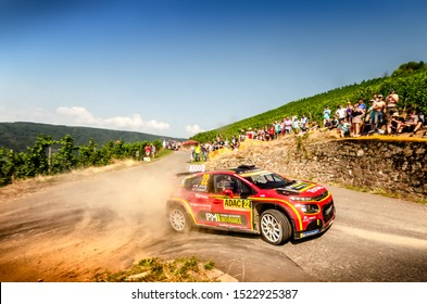 BOSTALSEE, GERMANY - AUG 23: Norwegian driver Mads Ostberg and his codriver Torstein Eriksen in a Citroen C3 R5 race in the ADAC Rallye Deutschland 2019, on Aug 23, 2019 in Bostalsee, Germany.