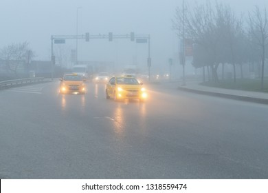 Bostanci, ISTANBUL - February 20, 2019 : Heavy fog and traffic on city road in Istanbul. TURKEY