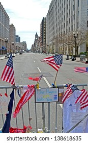 BOSTON - APR 20: American flags on Memorial set up on Boylston Street in Boston, USA on April 20, 2013. 3 people killed and over 100s injured during Boston Marathon bombing on April 15, 2013.