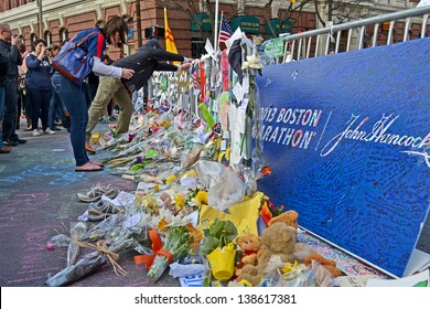 BOSTON - APR 20: People poured over the memorial set up on Boylston Street in Boston, USA on April 20, 2013. 3 people killed and over 100s injured during Boston Marathon bombing on April 15, 2013.