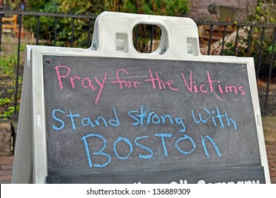 BOSTON - APR 20: Pray for the victims as text near Boylston Street in Boston, USA on April 20, 2013. 3 people killed and over 100s injured during Boston Marathon bombing on April 15, 2013.