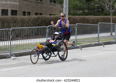 BOSTON - APRIL 15 : Team Hoyt runs in their 34th Boston Marathon on April 17, 2017 in Boston [public race]